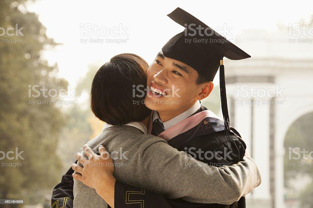 Mother and Graduate Hug stock photo
