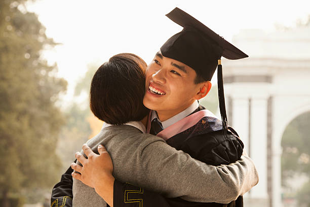 Mother and Graduate Hug stock photo