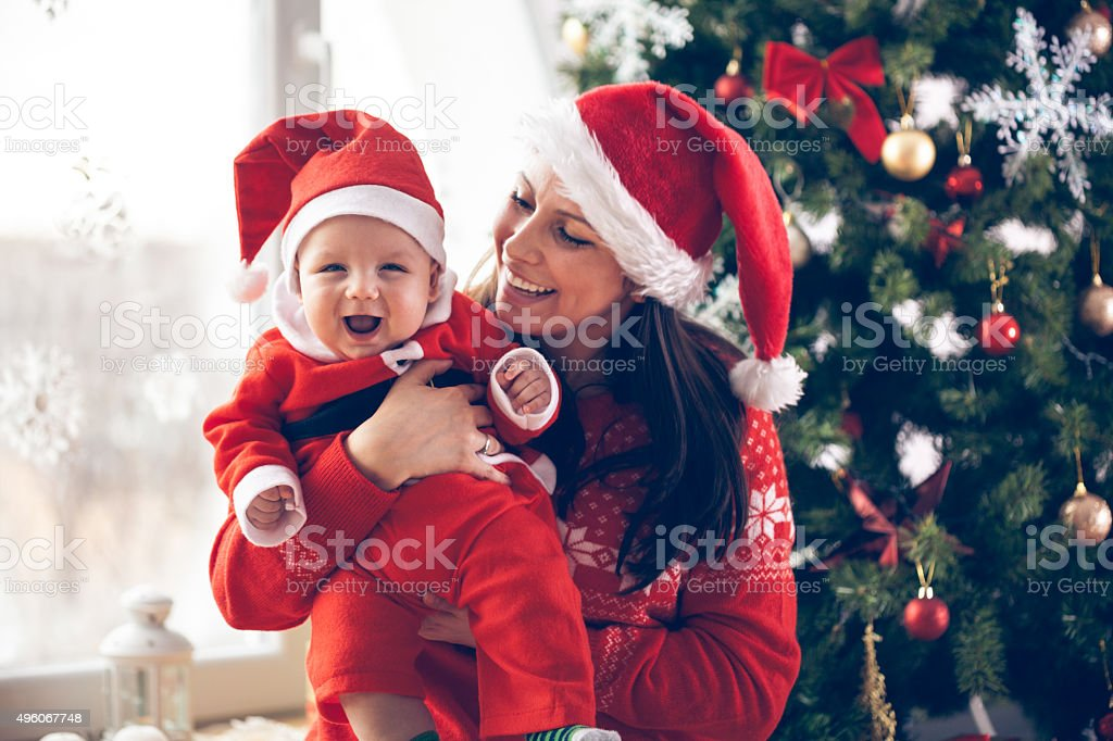Mother and her baby boy enjoying Christmas stock photo