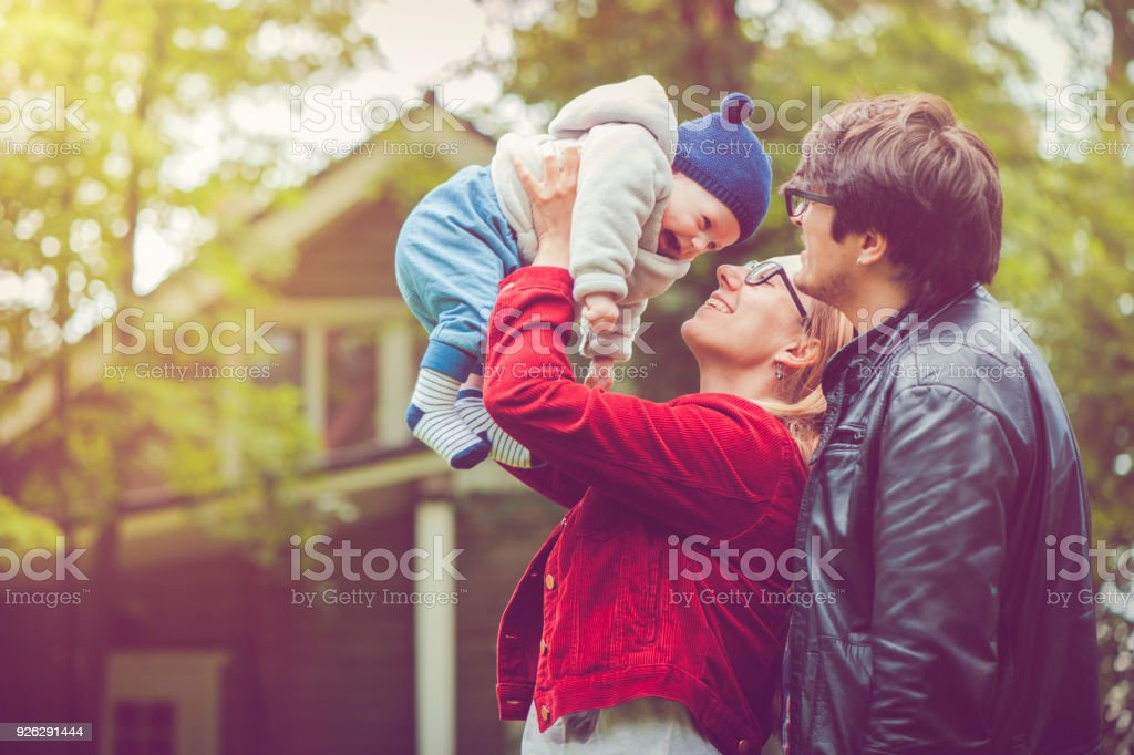 Mother and her baby boy near house stock photo