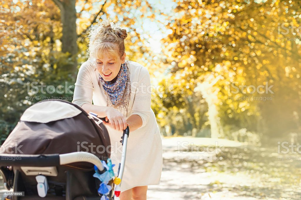 Mother and her baby in a park stock photo