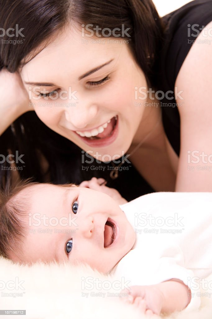 Mother and her child both smiling royalty-free stock photo