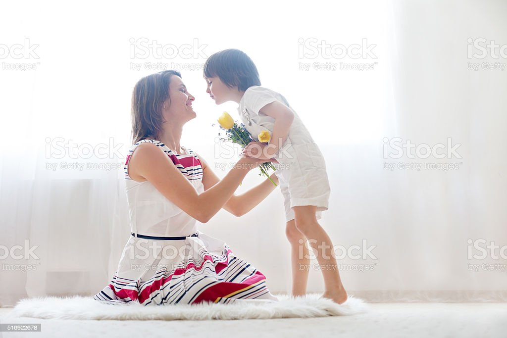 Mother and her child, embracing with tenderness and care stock photo