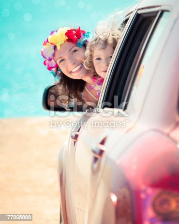 147878016 istock photo A mother and her child on a summer car trip with flowers 177865888
