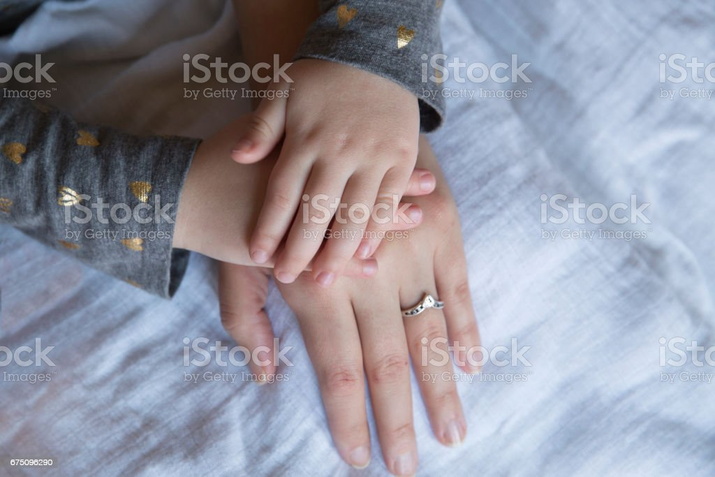 A Mother and her Child's Hands stock photo
