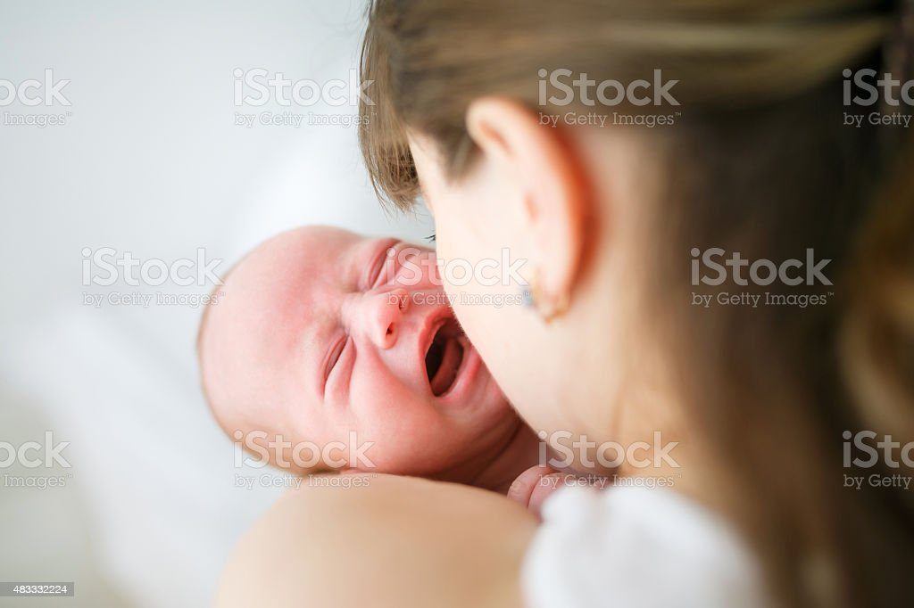 Mother and her crying little son stock photo