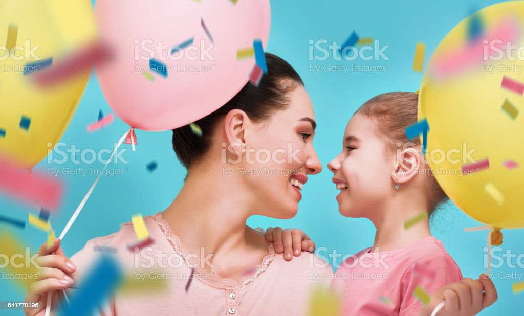 Mother and her daughter are having fun stock photo