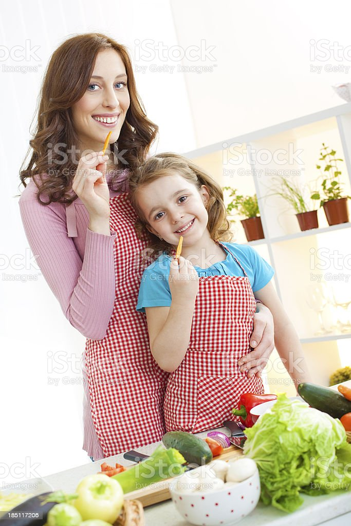 Mother and her daughter cooking. royalty-free stock photo