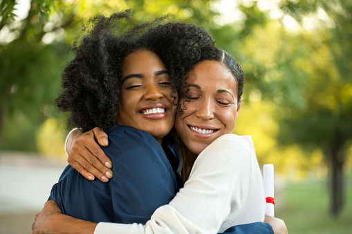 istock Mother and her daughter hugging at her graduation 1081187092