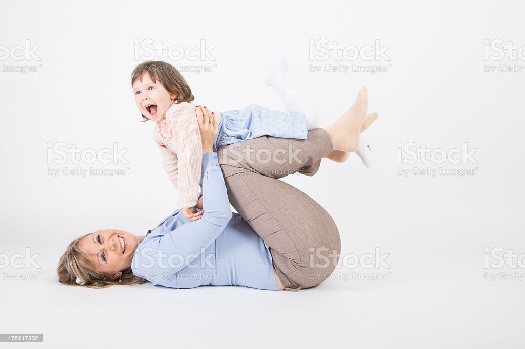 Mother and her daughter laughing and playing. stock photo