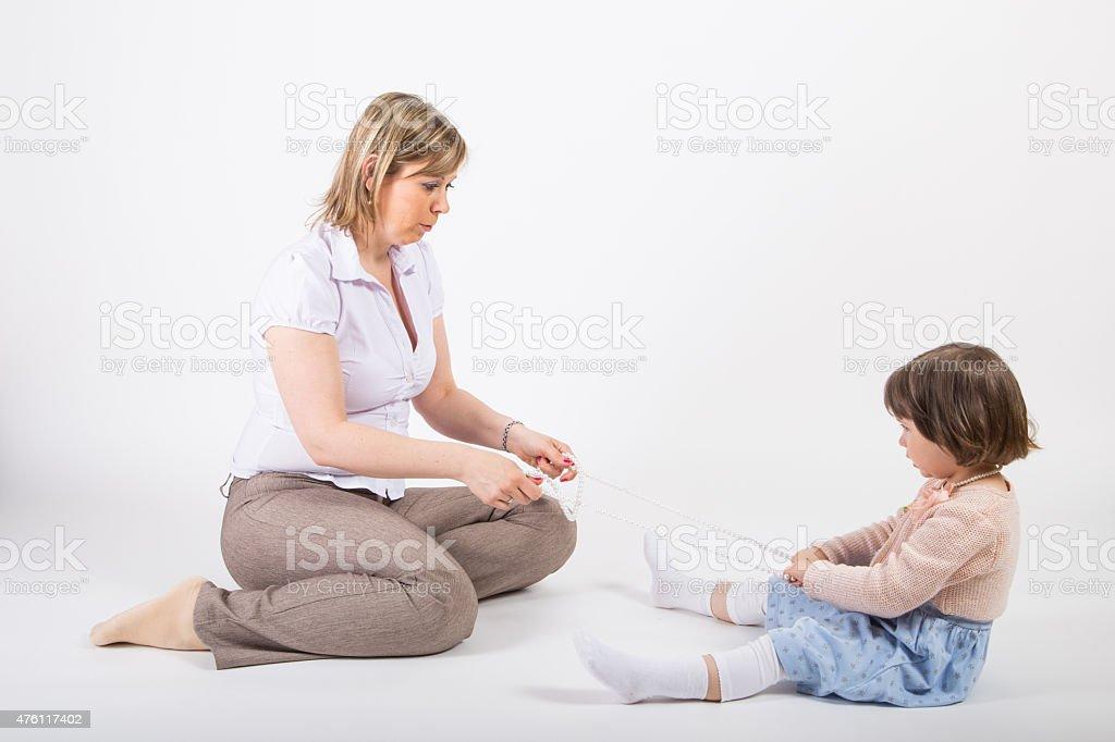 Mother and her daughter palying together stock photo