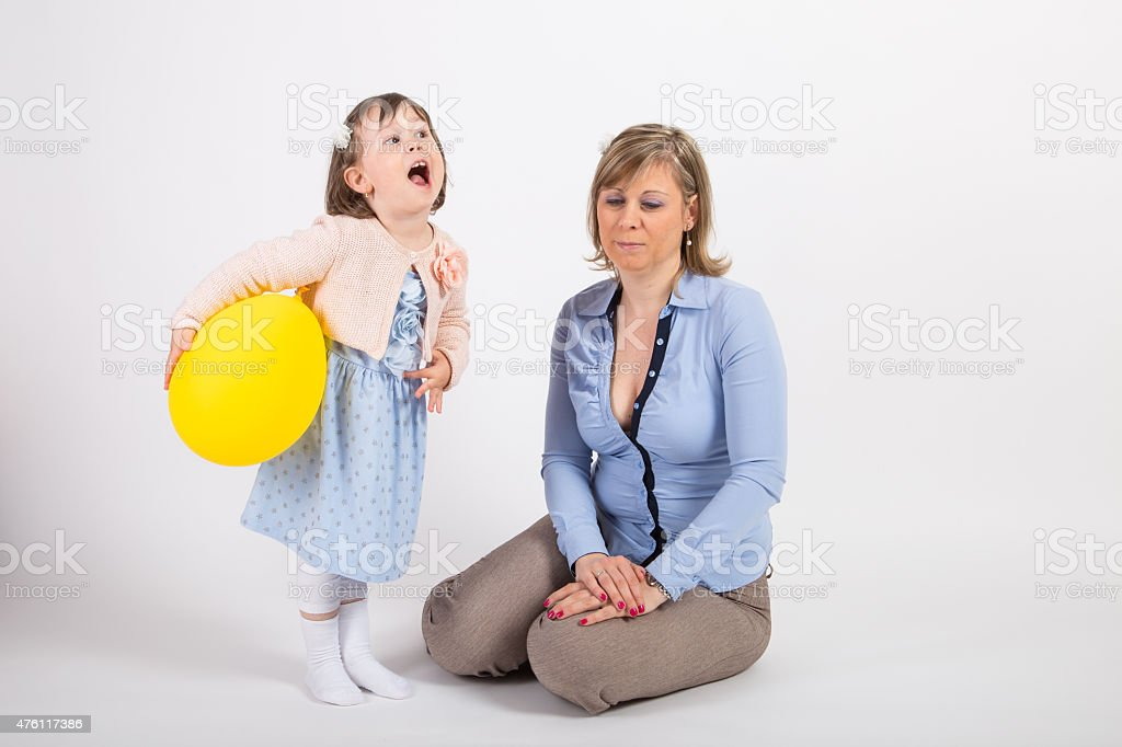 Mother and her daughter playing in a studio stock photo