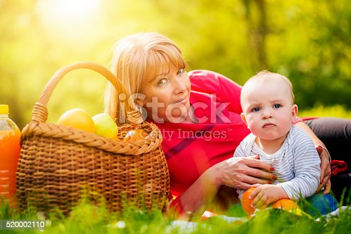 istock Mother and her little son in sunny park 520002110