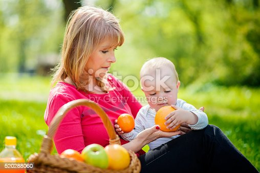 istock Mother and her little son in sunny park 520288060