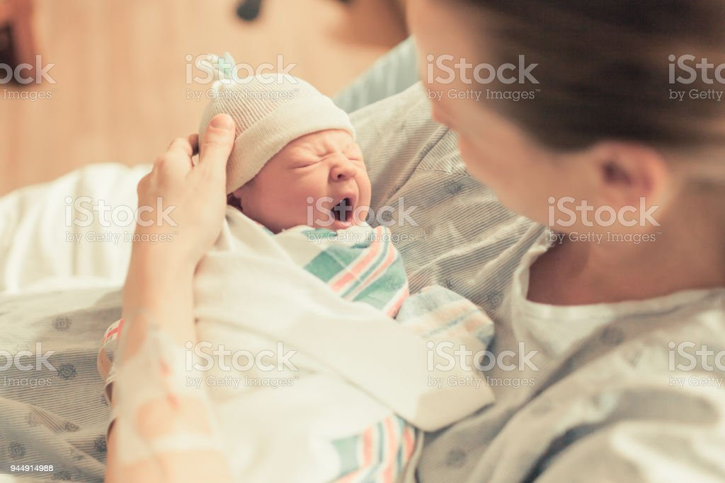 Mother and her newborn baby stock photo