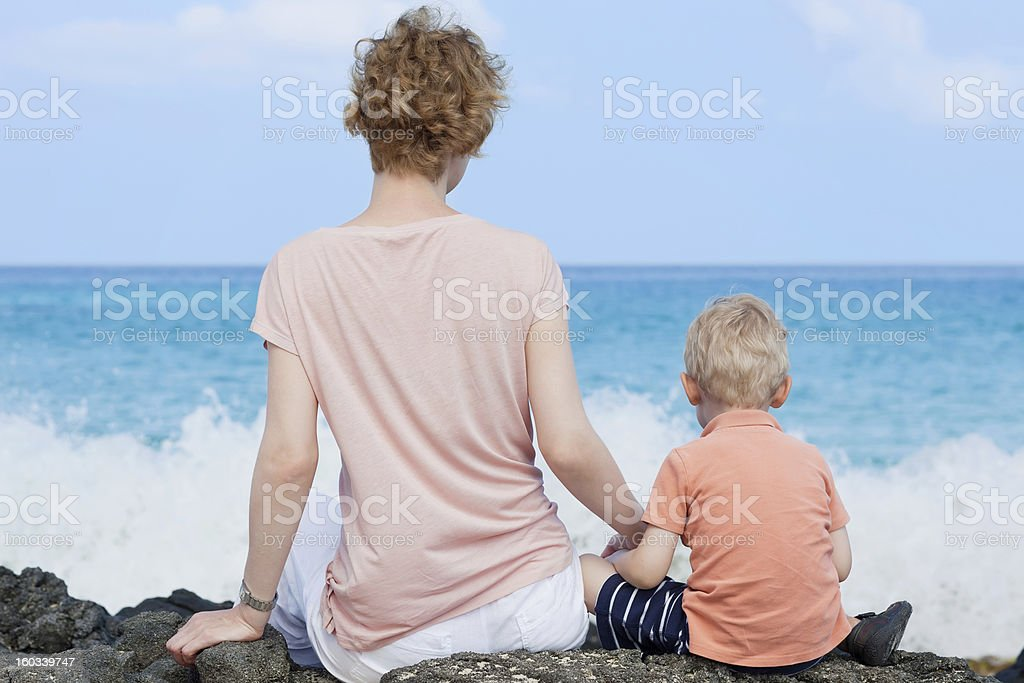 mother and her son at the beach royalty-free stock photo
