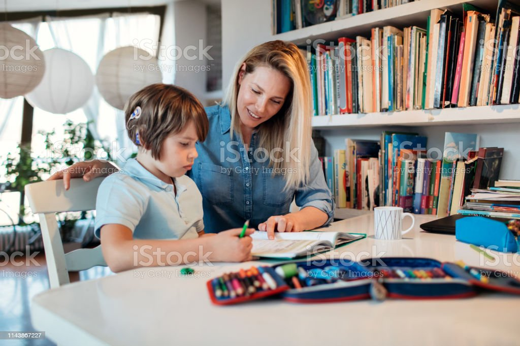 Mother And Her Son Doing Homework - Royalty-free 30-39 Years Stock Photo
