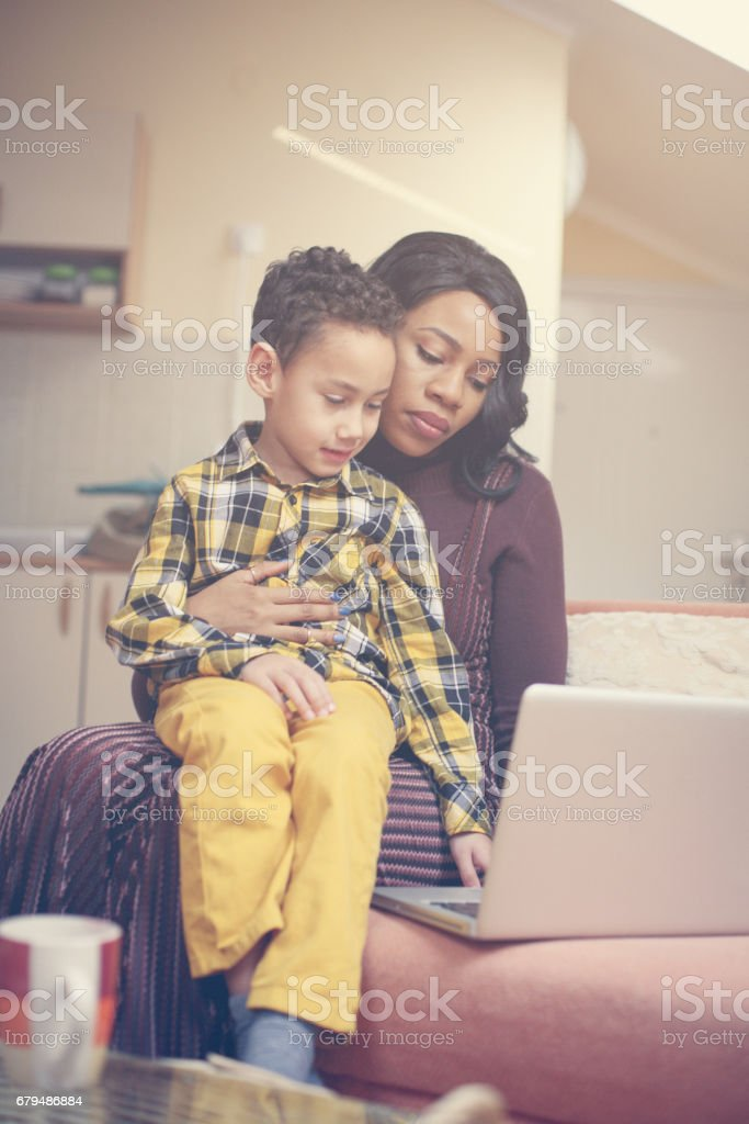 Mother and her son watching something on laptop. royalty-free stock photo