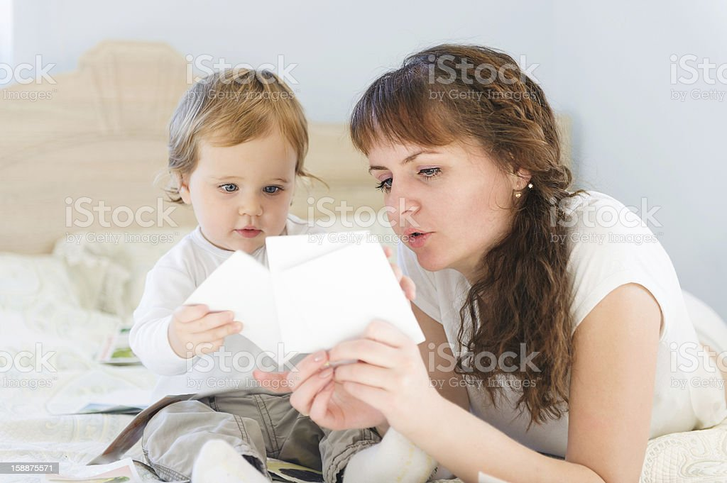 Mother and her son with paper cards stock photo