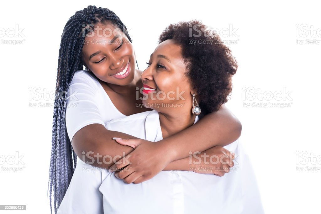 mother and her teenage daughter isolated on white stock photo