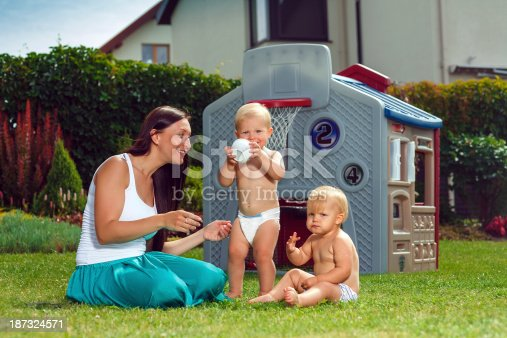 172407626istockphoto Mother and her twins 187324571
