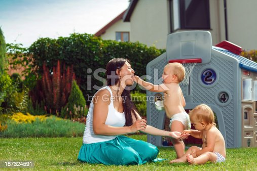 172407626istockphoto Mother and her twins 187324591