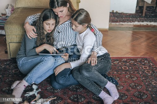 istock Mother and her two daughters 1147787553