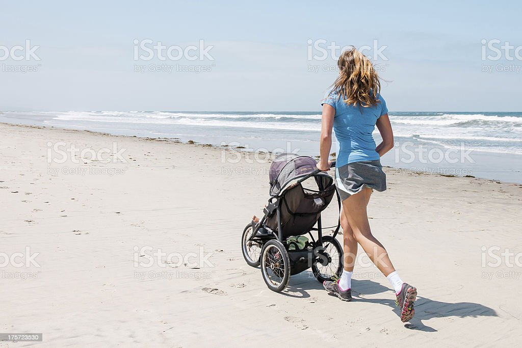 Mother and Infant on the Beach stock photo