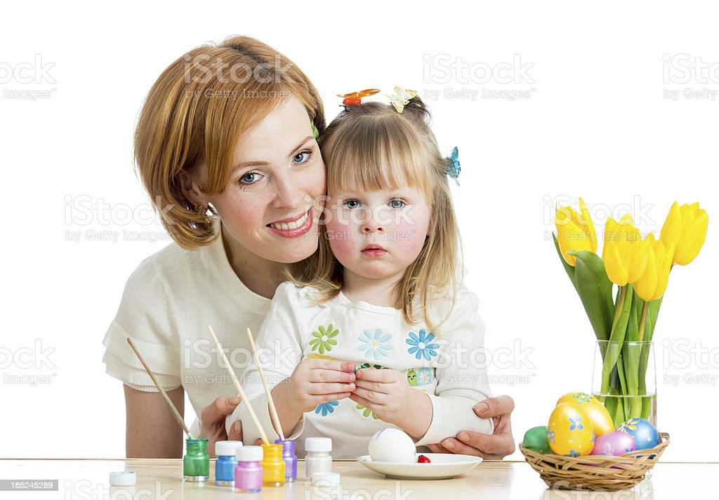 mother and kid girl paint easter eggs isolated on white royalty-free stock photo