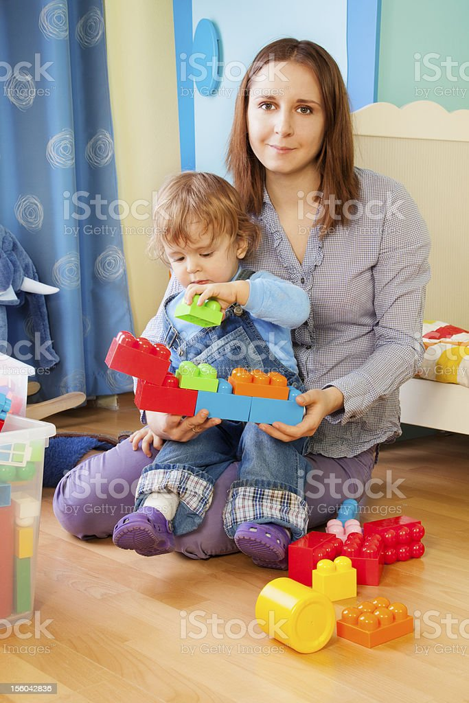 Mother and kid - playing with blocks royalty-free stock photo