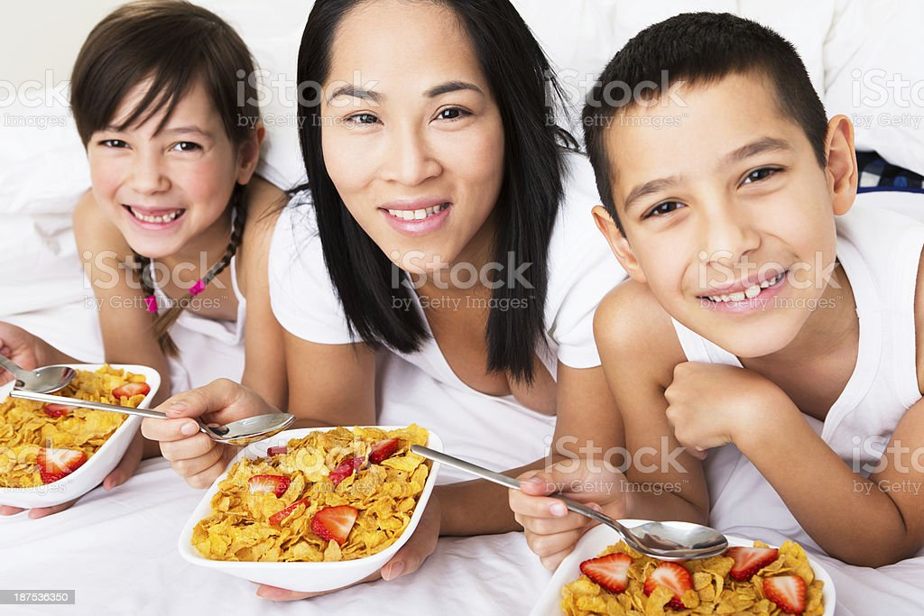 Mother And Kids Having Breakfast In Bed Stock Photo Download Image Now Istock