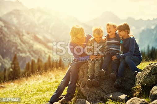 istock Mother and kids hiking in mountains 515779601