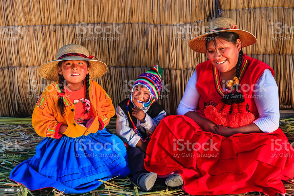 Mother and kids on Uros floating island, Lake Tititcaca, Peru stock photo