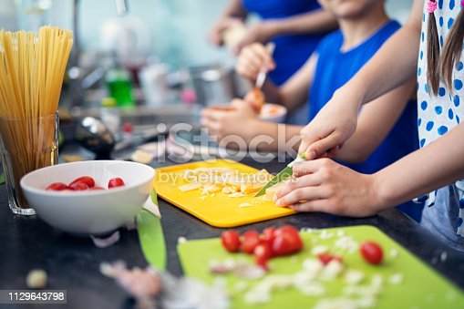 istock Mother and kids preparing lunch 1129643798