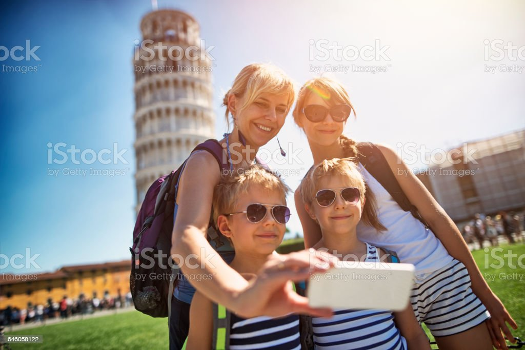 Mother and kids taking selfie in Pisa stock photo