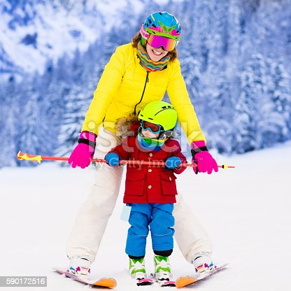 istock Mother and little boy learning to ski 590172516