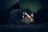 Mother and little boy playing with dinosaur shadows