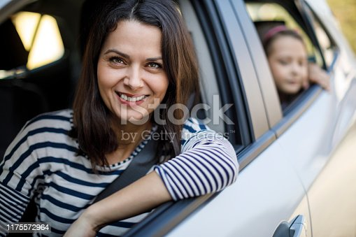 829619540 istock photo Mother and little daughter driving in car together 1175572964