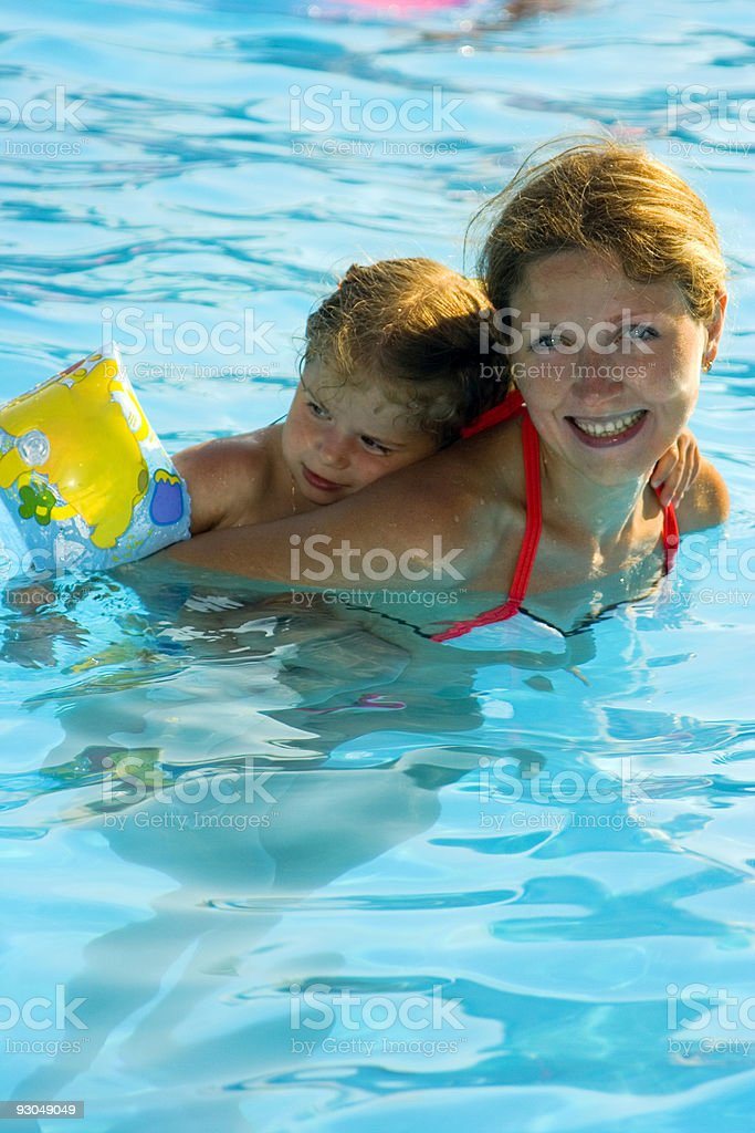 Mother and little daughter in the pool royalty-free stock photo