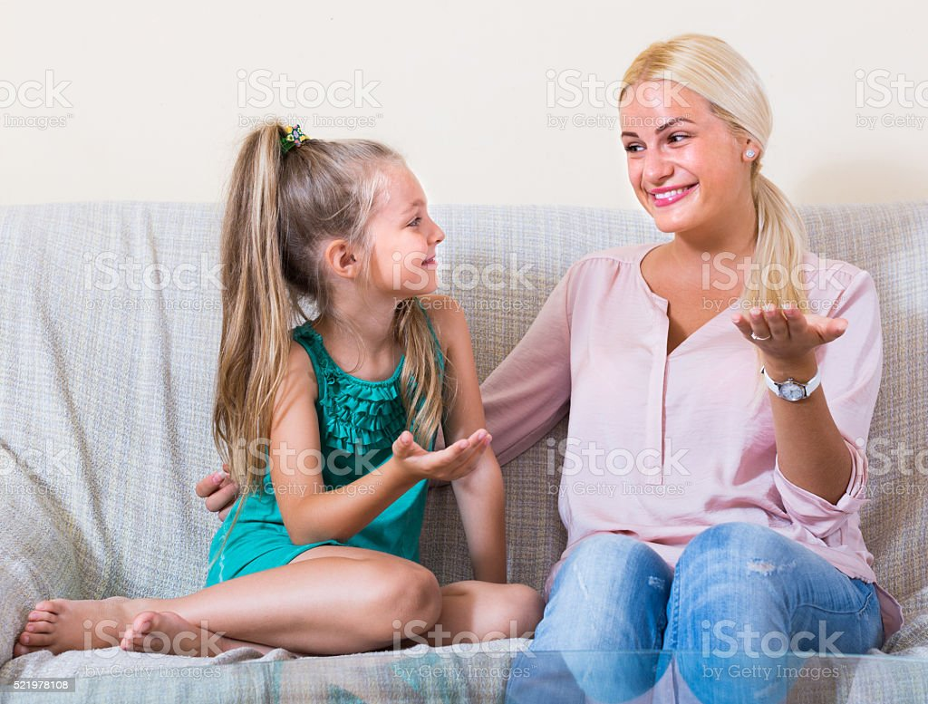 Mother and little daughter indoors stock photo