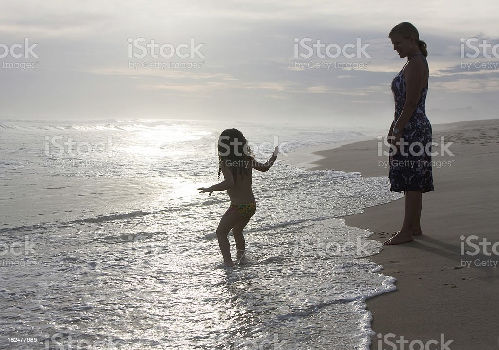 Mother and Little Daughter On The Beach royalty-free stock photo