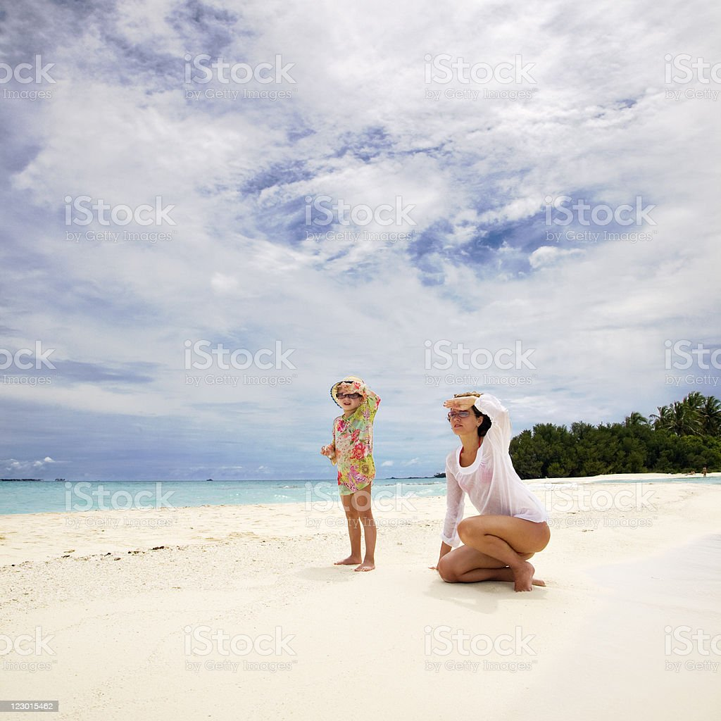 Mother and Little Daughter on Tropical Beach royalty-free stock photo