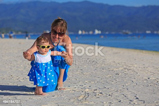 istock mother and little daughter on tropical beach 494184707
