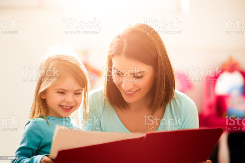 Mother and little daughter stock photo