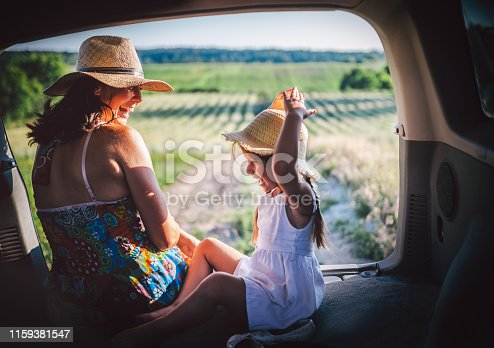 930810564 istock photo Mother and little daughter travel by car 1159381547