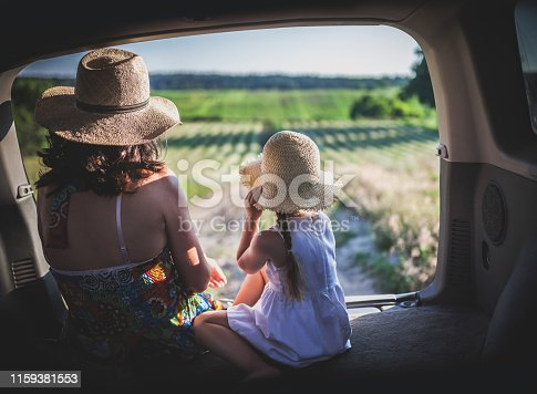930810564 istock photo Mother and little daughter travel by car 1159381553