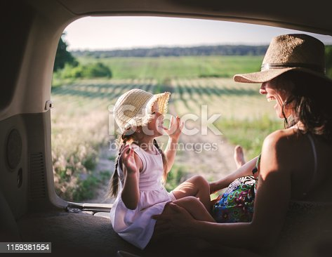930810564 istock photo Mother and little daughter travel by car 1159381554