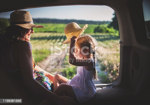 930810564 istock photo Mother and little daughter travel by car 1159381555