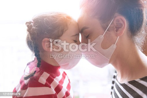 mother and little daughter wearing surgial mask