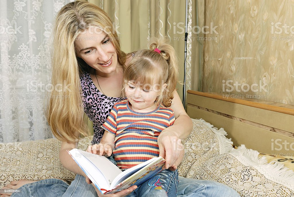 Mother and little girl reading royalty-free stock photo